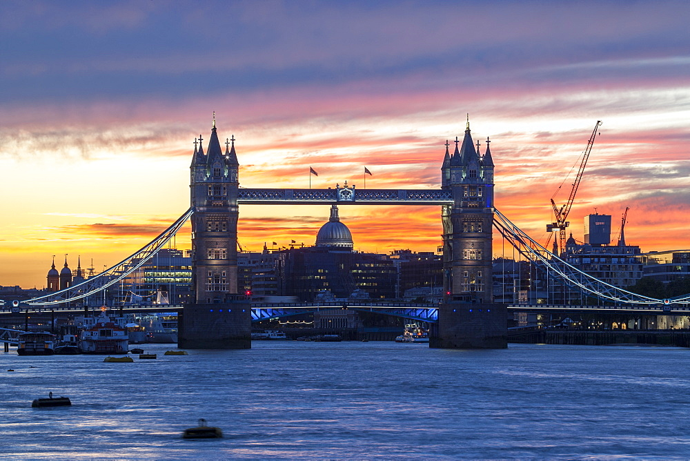 Tower Bridge, St. Paul's Cathedral and the City skyline over the River Thames at sunset, London, England, United Kingdom, Europe - 1284-100