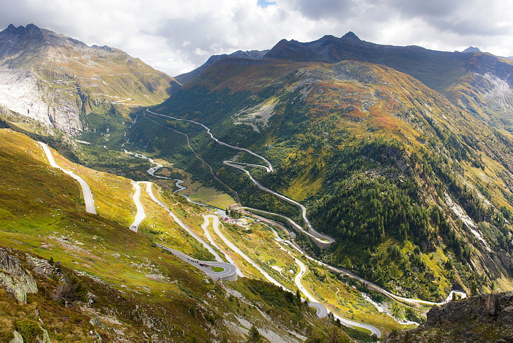 Twisting roads of the Furka and Grimsel Alpine Passes meet at the hamlet of Gletsch, Canton of Valais, Switzerland, Europe - 1284-179