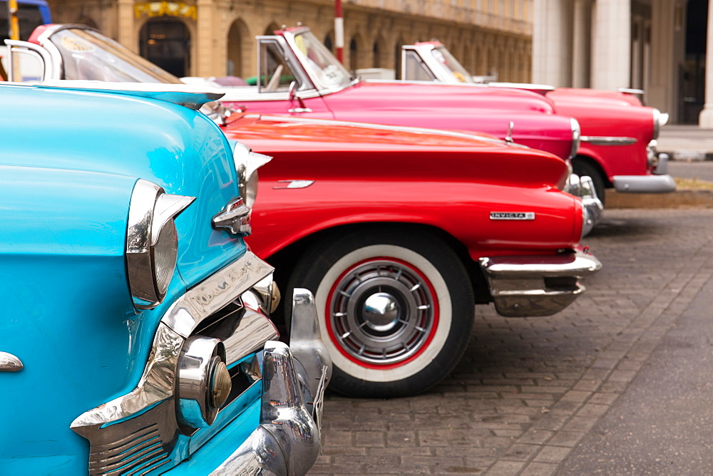 Colourful old Amerincan cars parked in Havana, Cuba, West Indies, Caribbean, Central America