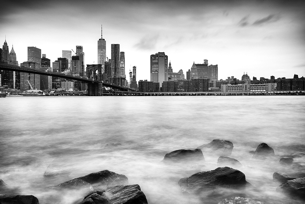 Brooklyn Bridge and Lower Manhattan skyline taken from Pebble Beach, New York City, New York, United States of America, North America