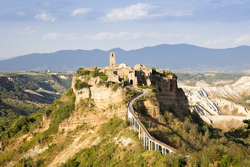 Civita di Bagnoregio, a medieval town perched on volcanic rock, in the afternoon sun, Lazio, Italy, Europe