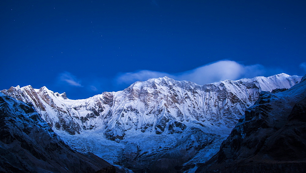 Clouds and stars at night over Annapurna, image taken from Base Camp in the Sanctuary, Himalayas, Nepal, Asia - 1287-1