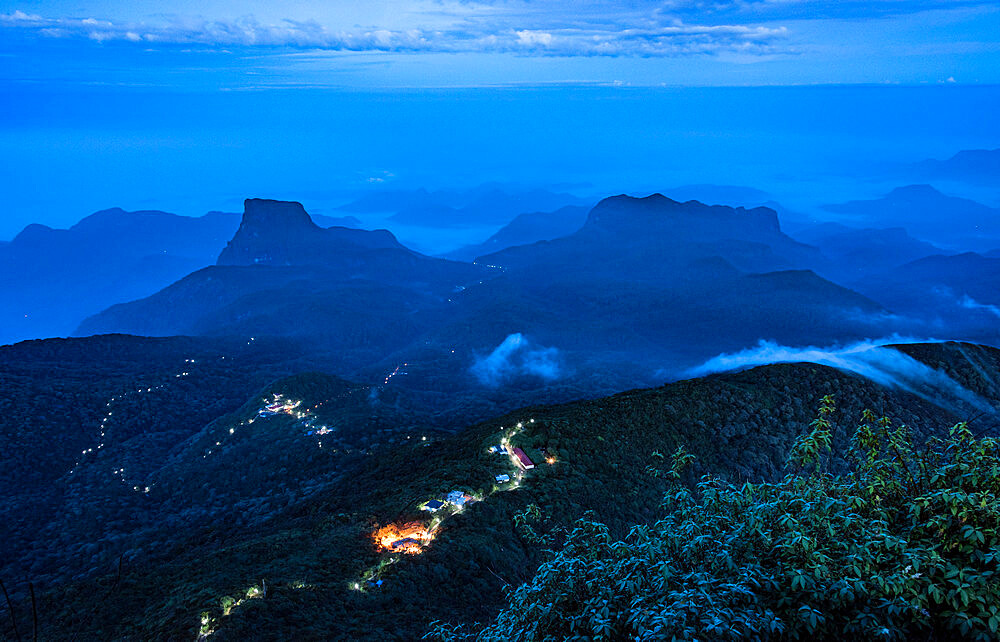 Lights marking the pilgrim trail through the forest to Sri Pada (Adams Peak), an important pilgrim site in Sri Lanka, Asia