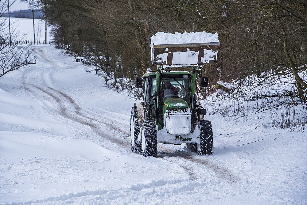 A tractor trying to clear the main road between Lennoxtown and Strathblane, East Dunbartonshire, Scotland, United Kingdom, Europe - 1287-44