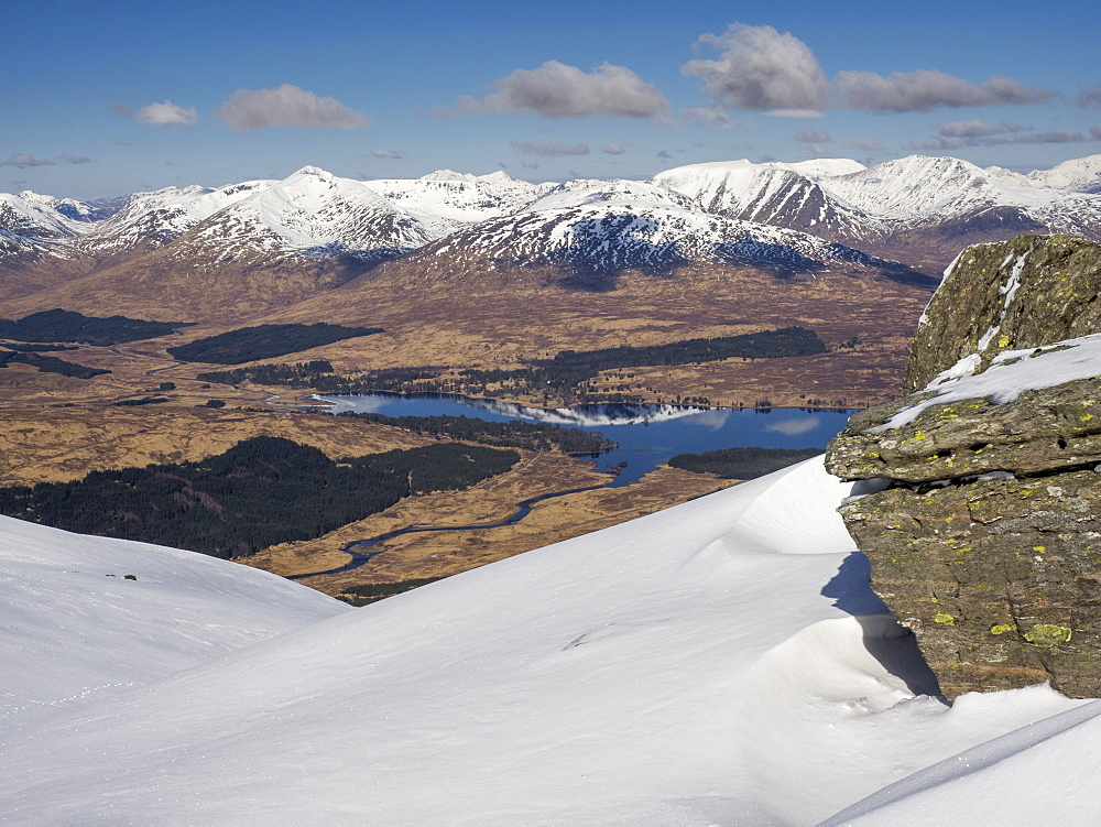 Loch Tulla and the snow capped Blackmount viewed from Beinn Dorain near Bridge of Orchy in the Scottish Highlands, Scotland, United Kingdom, Europe