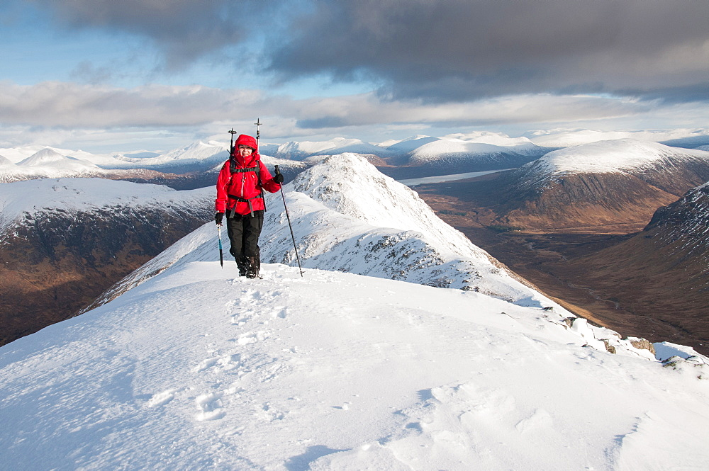 A female walker approaching the summit of Stob Dubh on Buchaille Etive Beag on a crisp winter day, Highlands, Scotland, United Kingdom, Europe - 1287-84