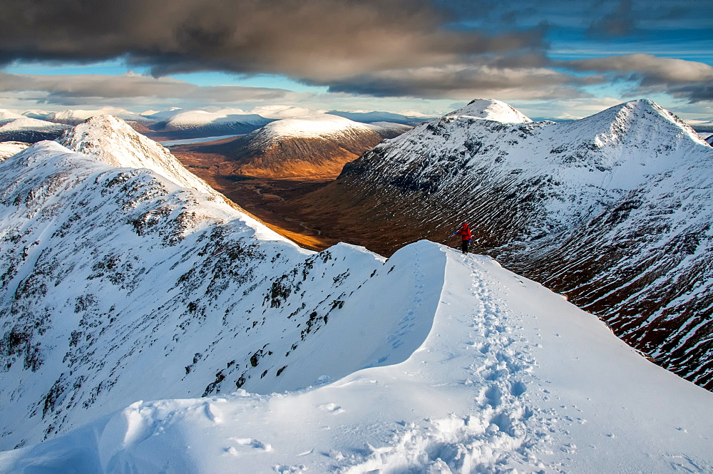 A female walker approaching the summit of Stob Dubh on Buchaille Etive Beag on a crisp winter day, Highlands, Scotland, United Kingdom, Europe - 1287-86