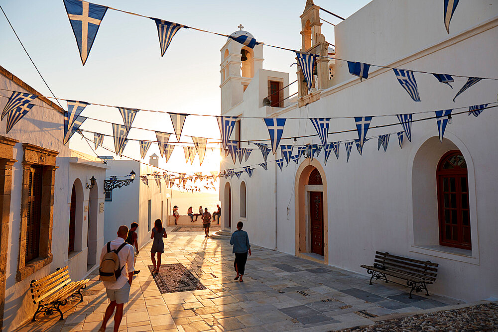 Sunset in Plaka, the main town on Milos island, with Greek Orthodox feast decoration on the church square with pebble mosaic, Plaka, Milos, Cyclades, Greek Islands, Greece, Europe - 1294-173