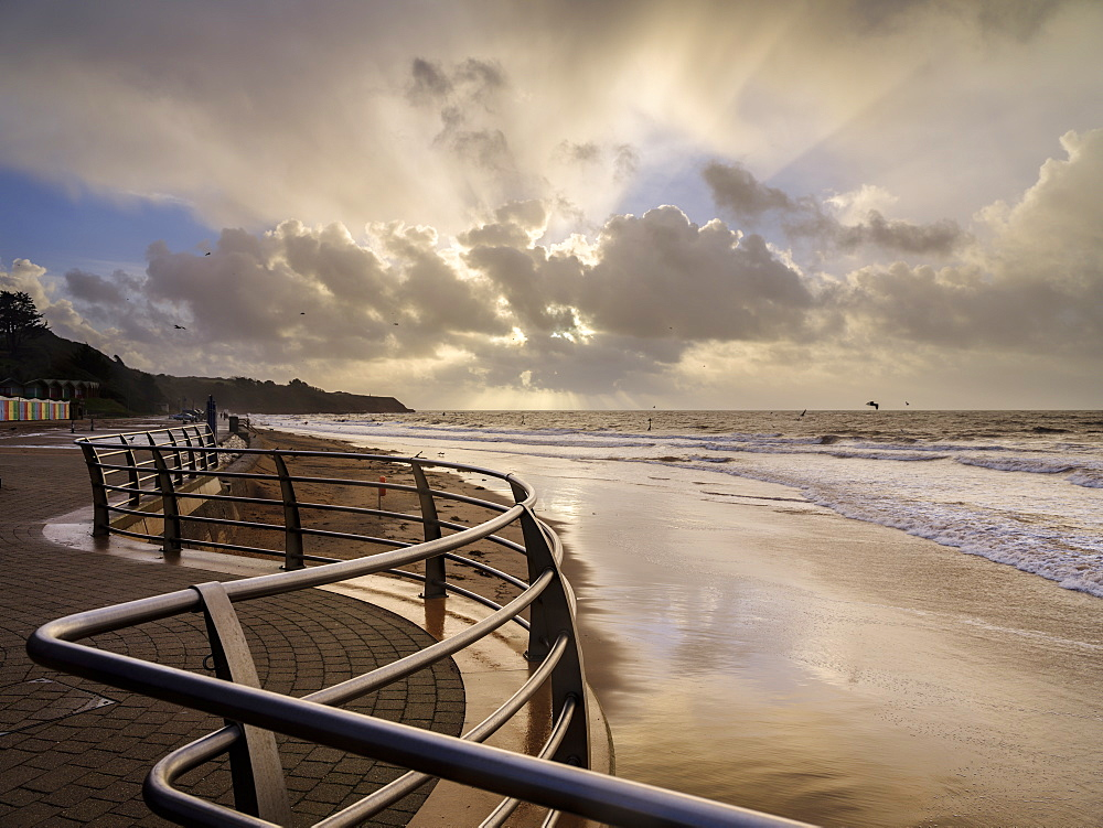Shimmering sand and railings in warm light Exmouth, Devon, England, United Kingdom, Europe