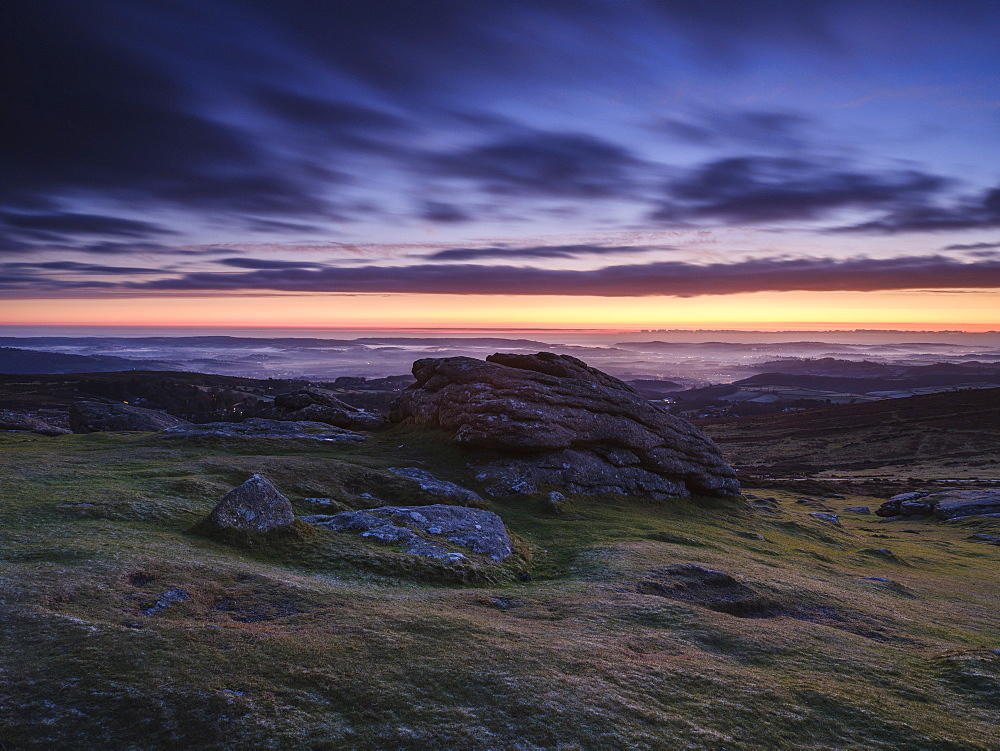 Dawn viewing East with mist in valleys, Dartmoor National Park seen from Haytor, Bovey Tracey, Devon UK