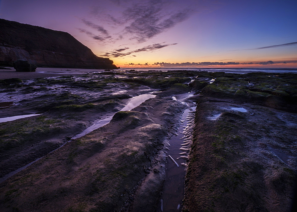 Winter twilight with razor shell and cloud formation, Orcombe Point, Exmouth, Devon, UK