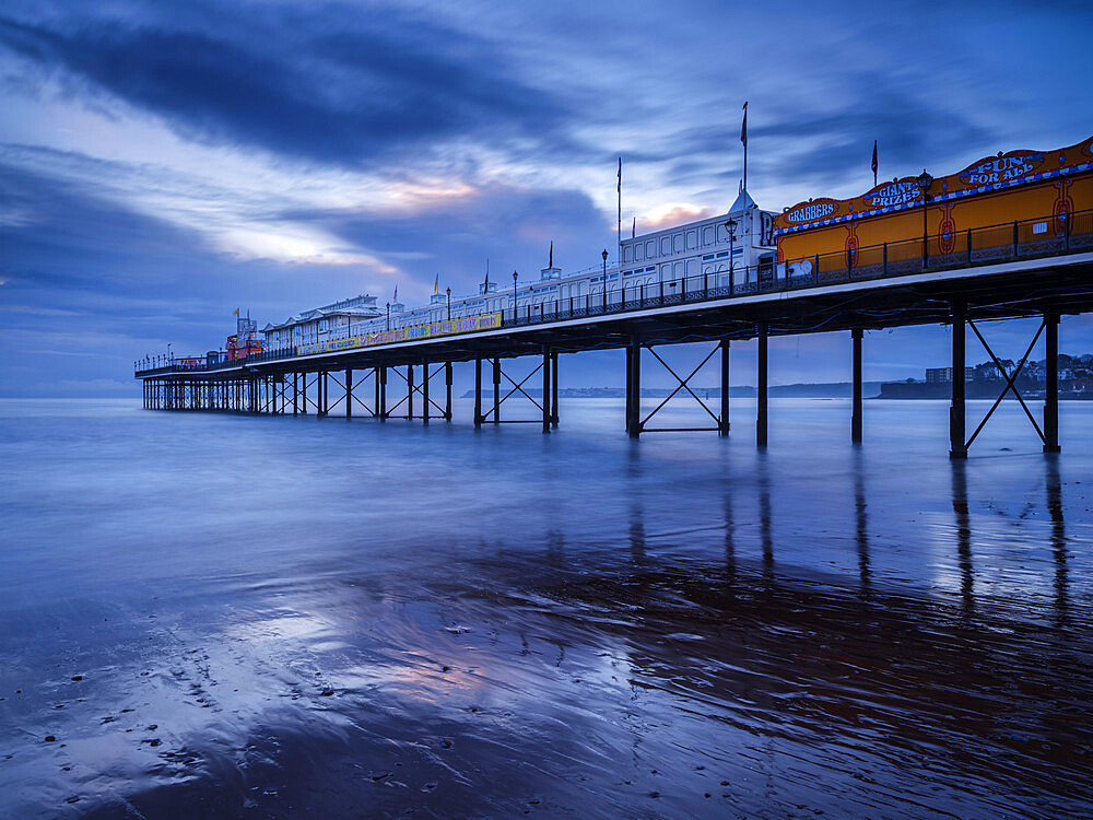 The photogenic Pier in dawn twilight at Paignton, Devon UK