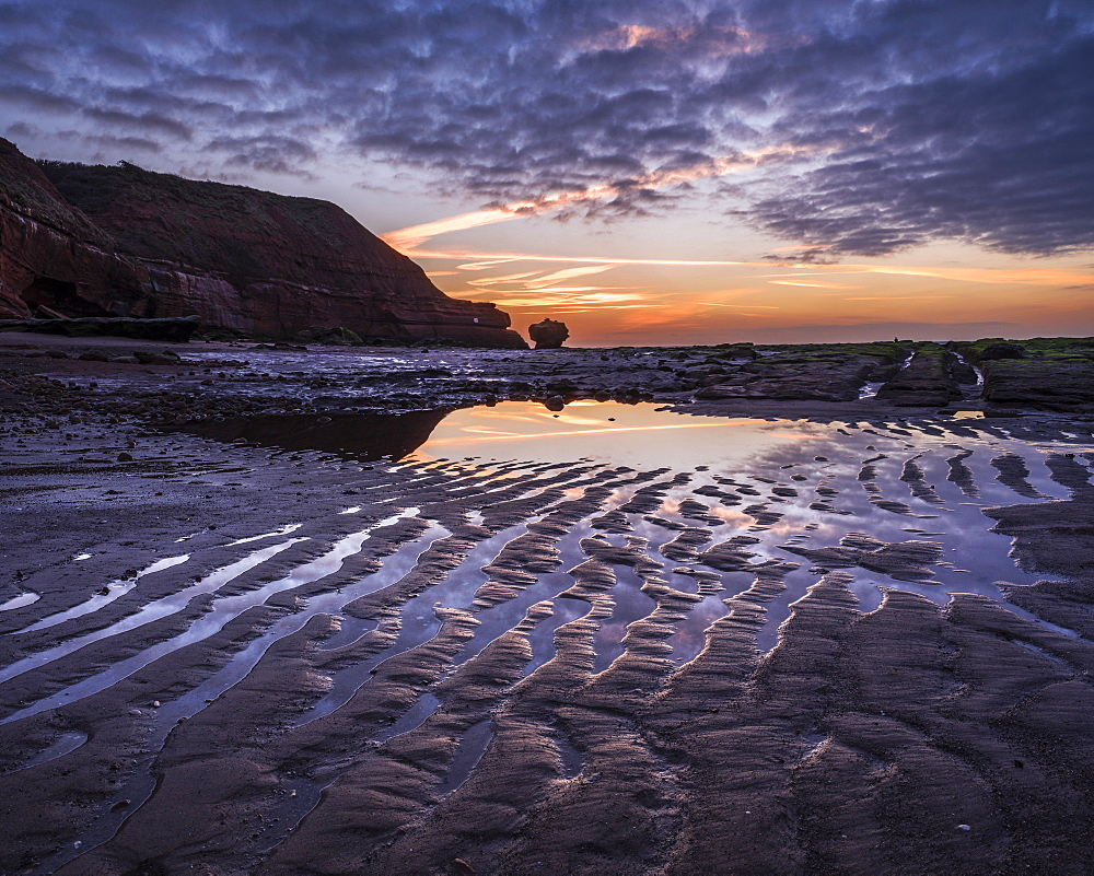 Sand ripples at dawn on the beach at Orcombe Point, Exmouth, Devon, UK.