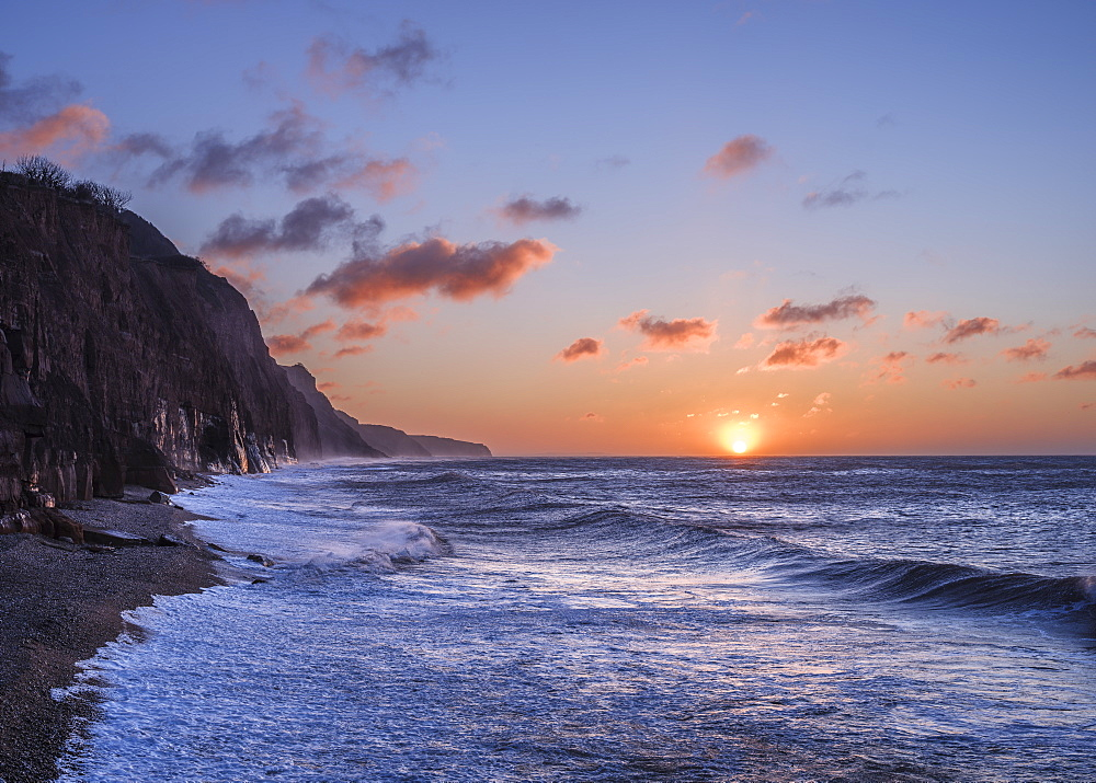 Stormy seas at sunrise at the cliffs in the seaside town of Sidmouth, Devon, England, United Kingdom, Europe