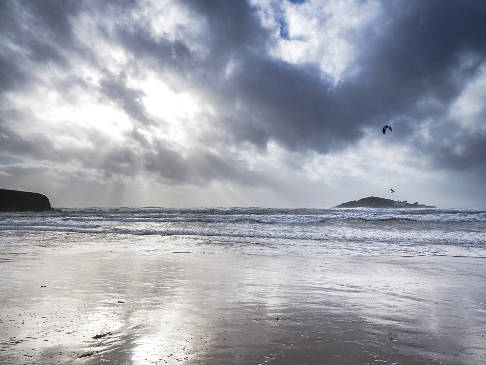A kitesurfer off the beach at Bantham during a storm, near Kingsbridge, Devon, UK - 1295-202