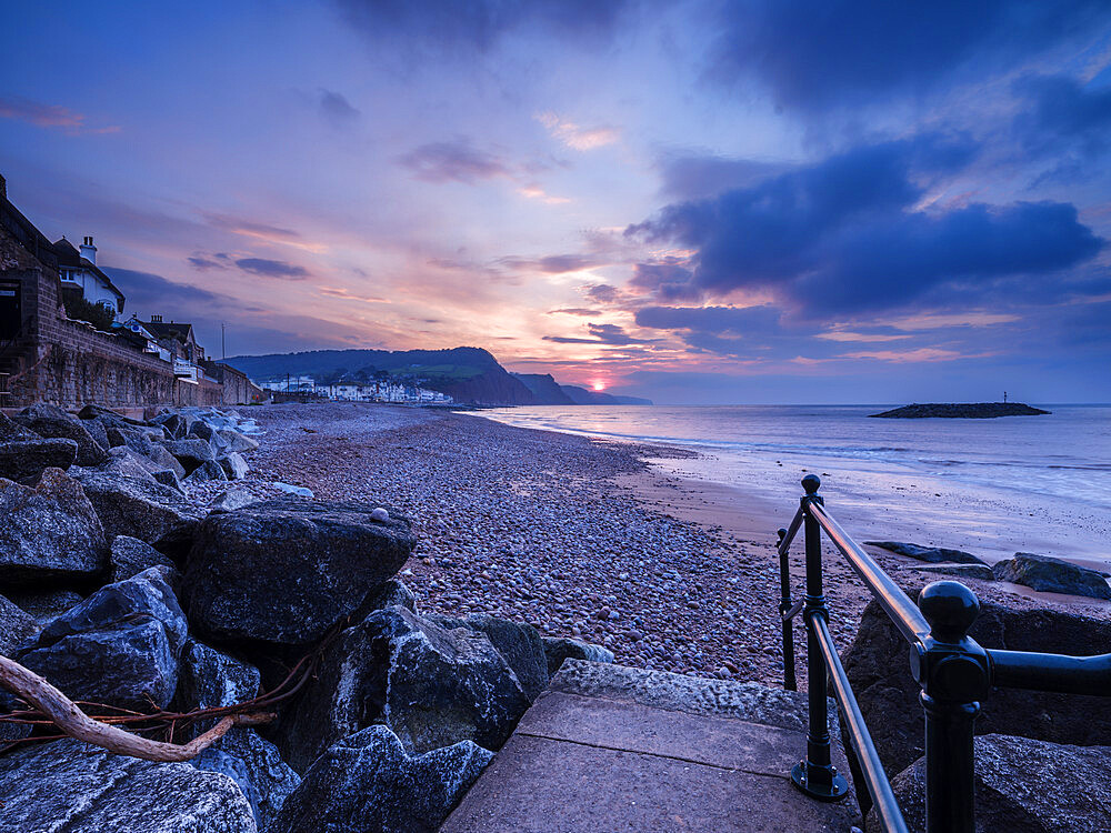 Sunrise looking along the beach at the picturesque seaside town of Sidmouth, Devon, UK - 1295-205