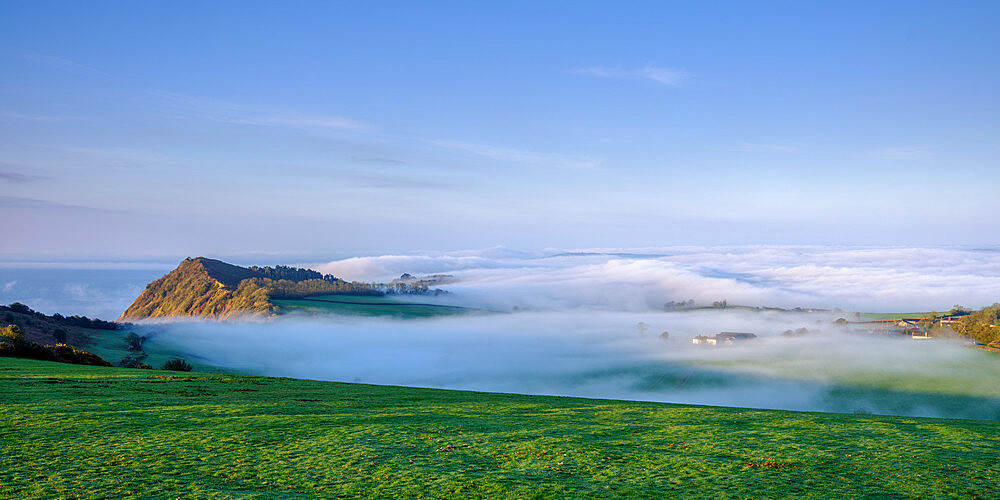 Spring with extensive fog and mist over Otterton and Ladram Bay viewed from Peak Hill, Sidmouth, Devon, UK - 1295-208