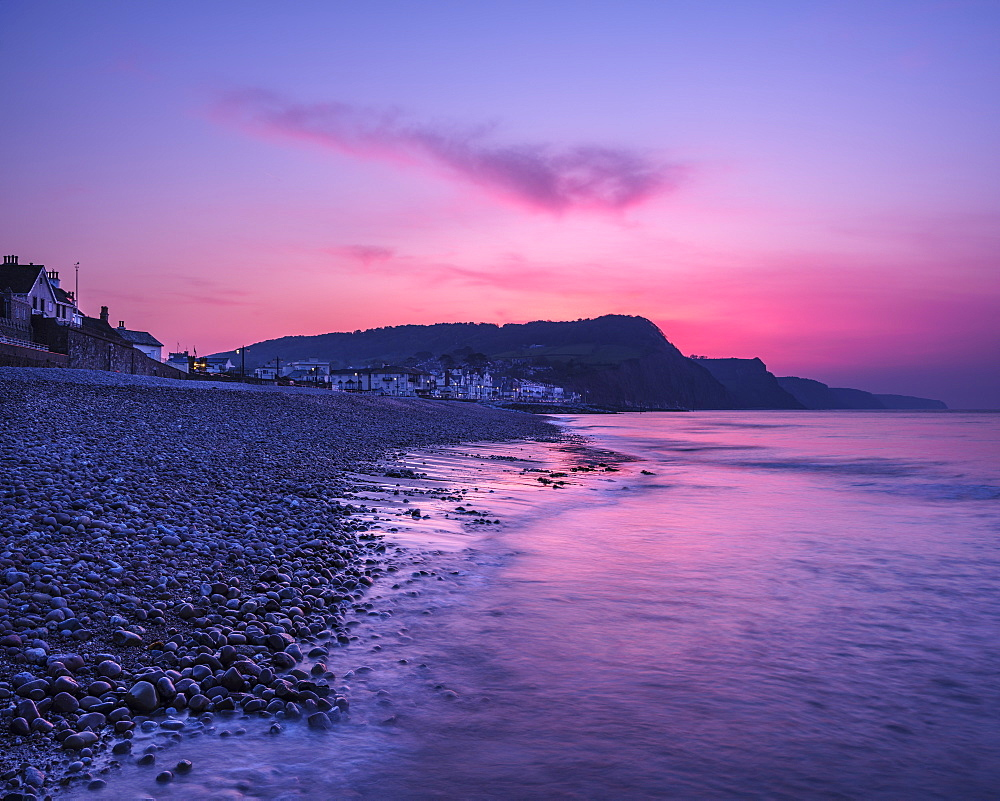 Vivid dawn twilight looking along the beach at the picturesque seaside town of Sidmouth, Devon, England, United Kingdom, Europe - 1295-214