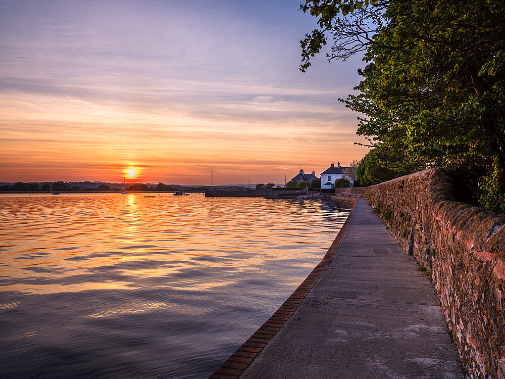 High tide sunset on The Goat Walk with a mirror calm River Exe at Topsham, Devon, UK - 1295-215