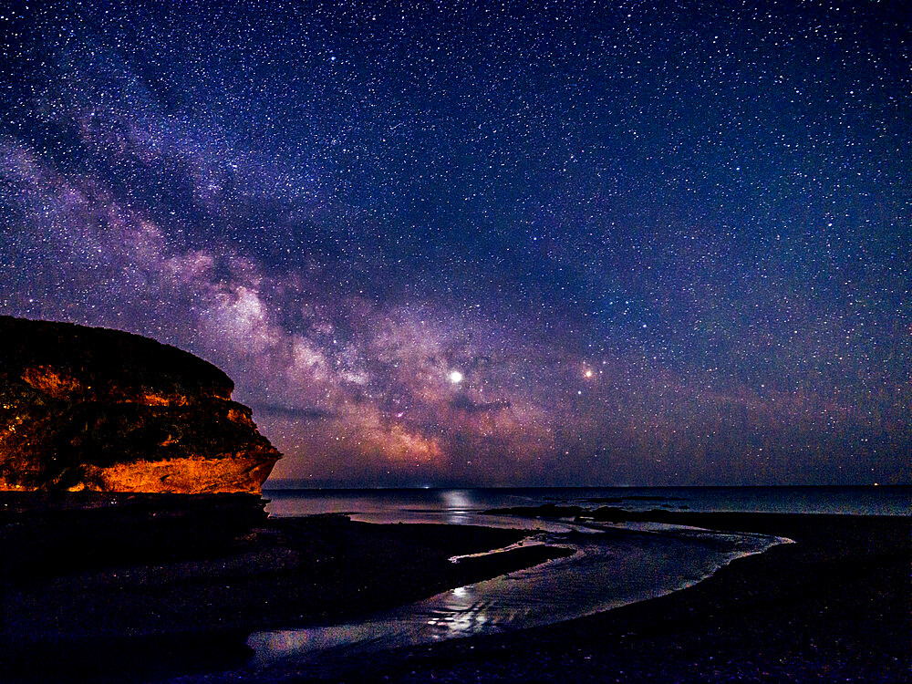 Milky Way and Jupiter beyond Otter Head at Budliegh Salterton, Devon, UK