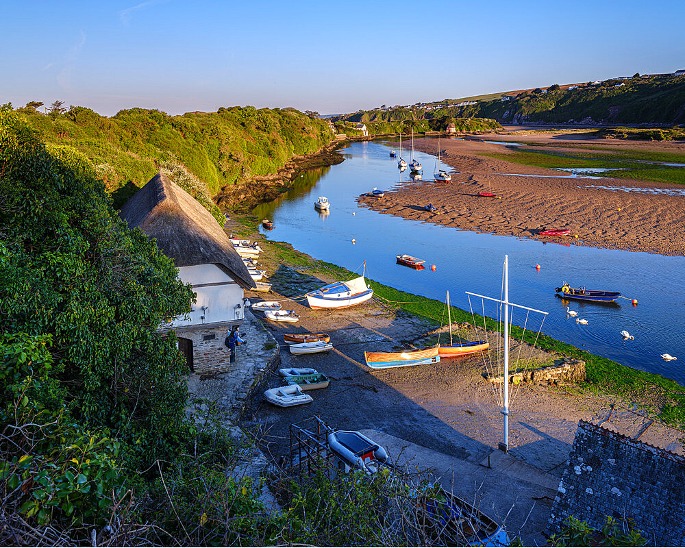 Scene overlooking Bantham Quay with array of boats and River Avon at Bantham, Devon, UK