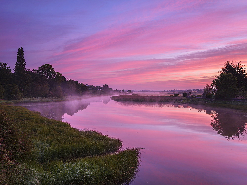 Dawn sky and rising mist from a mirror calm River Clyst at Topsham, Devon, England, United Kingdom, Europe - 1295-242
