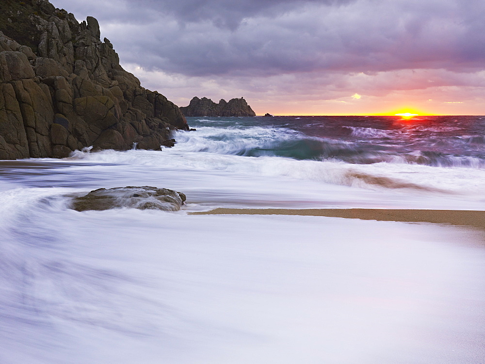 Early morning on the beach looking out towards Logan Rock at Porthcurno, Cornwall, England, United Kingdom, Europe - 1295-274