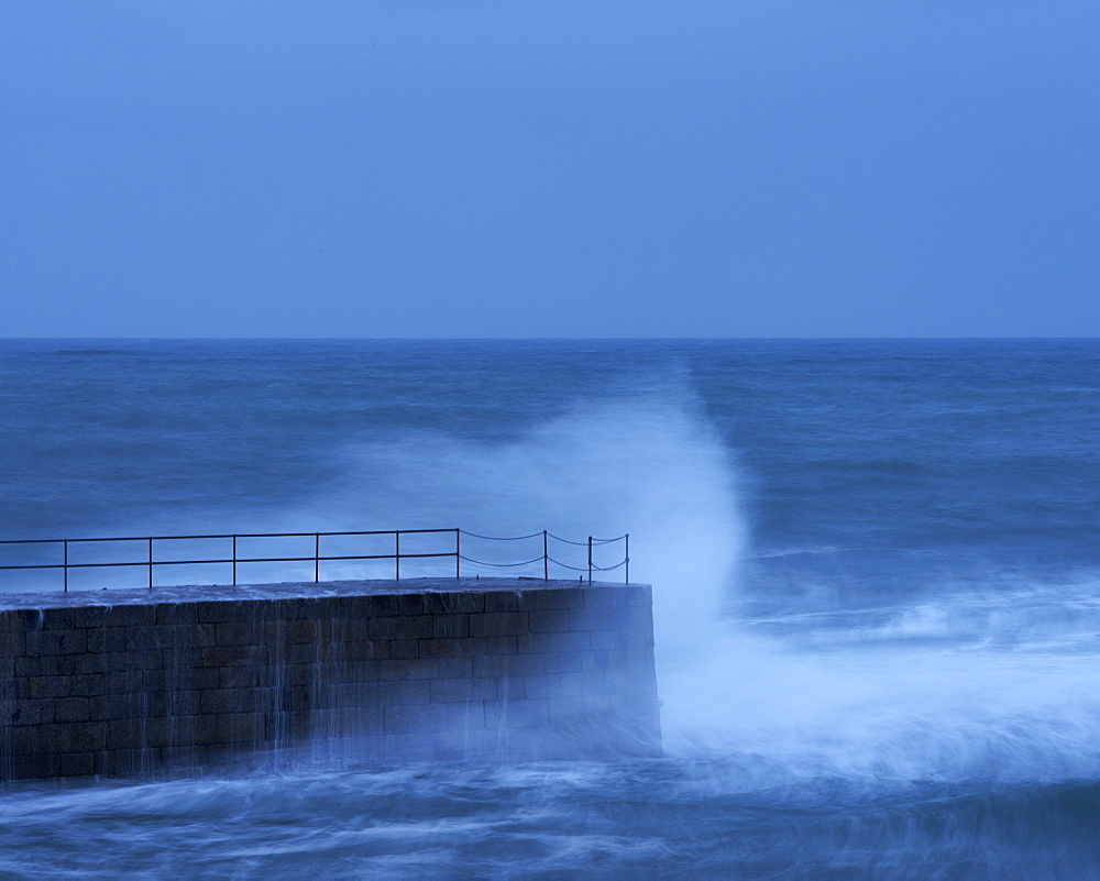 Wave in a storm strikes the breakwater at Porthleven in Cornwall, England, United Kingdom, Europe - 1295-277