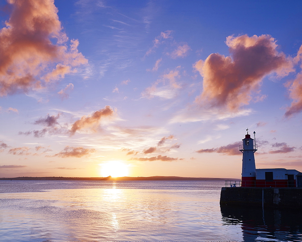 Summer sunrise on the harbour wall at the fishing port of Newlyn, Cornwall, UK
