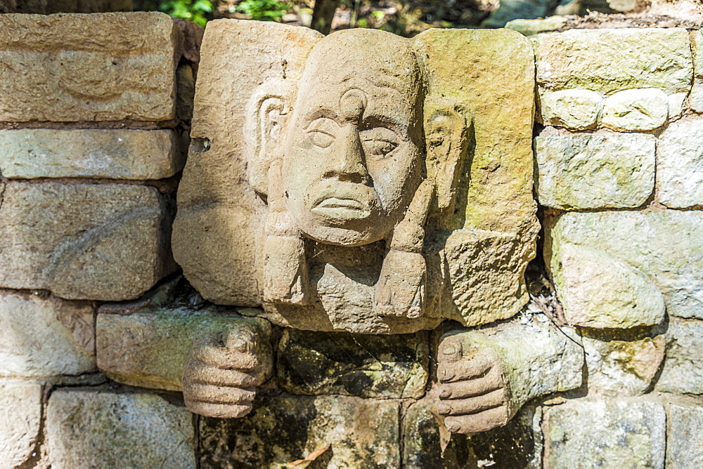 A carved face on a wall from Structure 29 in the Copan Ruins, UNESCO World Heritage Site, Copan, Honduras, Central America