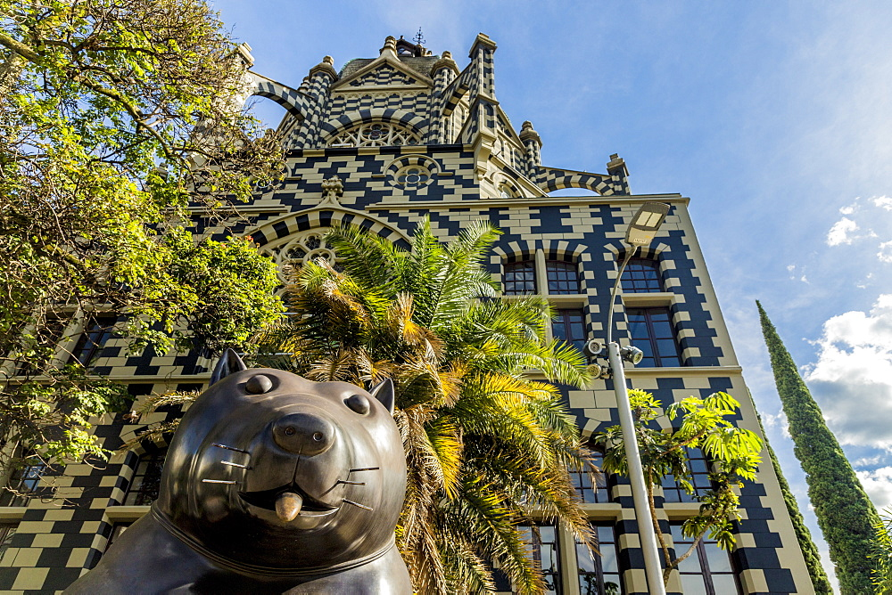 A view of the Rafael Uribe Uribe Palace of Culture with the Fernando Botero statue Perro (Dog) in the foreground, Medellin, Colombia, South America