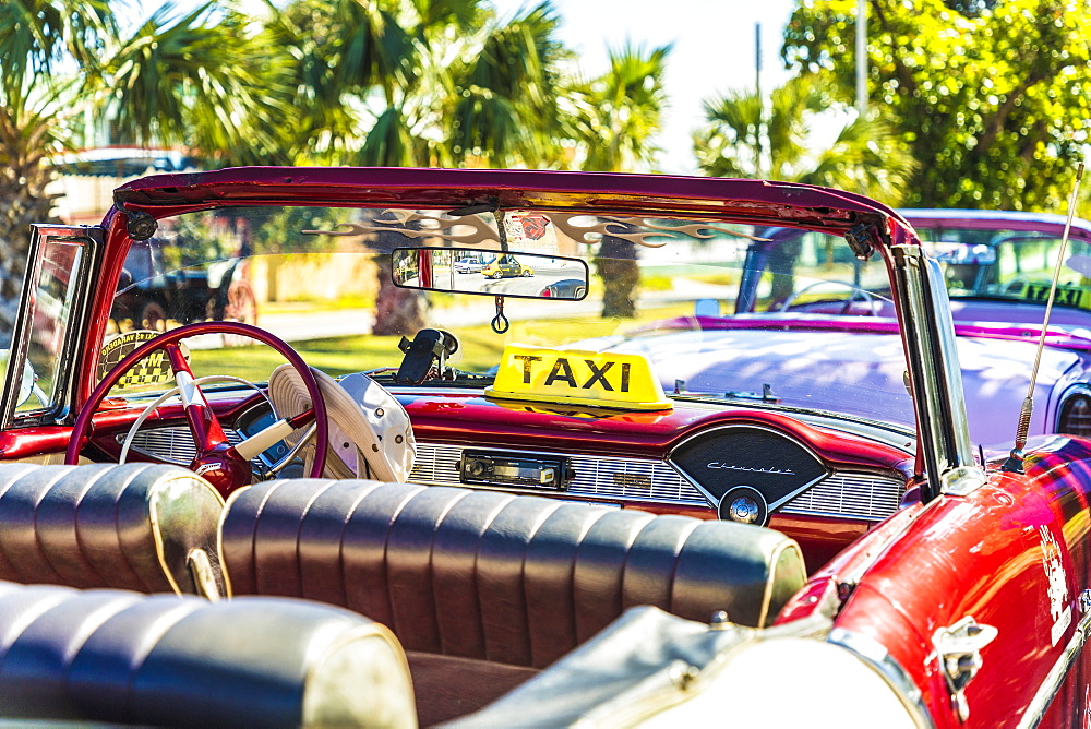 A view of a classic American car used as a taxi in Varadero, Cuba, West Indies, Caribbean, Central America