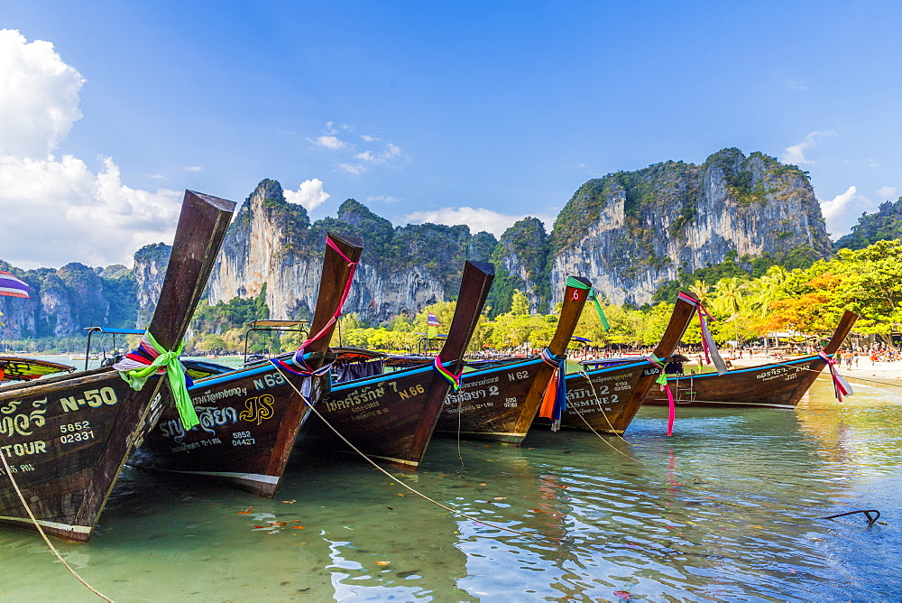 Long tail boats and karst scenery on Railay beach in Railay, Ao Nang, Krabi Province, Thailand, Southeast Asia, Asia.