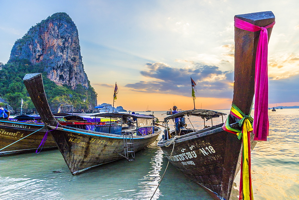 Long tail boats at sunset on Railay beach in Railay, Ao Nang, Krabi Province, Thailand, Southeast Asia, Asia.