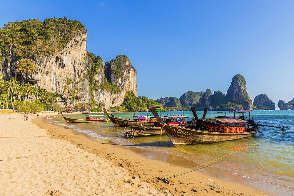Long tail boats on Tonsai beach and karst landscape in Railay, Ao Nang, Krabi Province, Thailand, Southeast Asia, Asia.