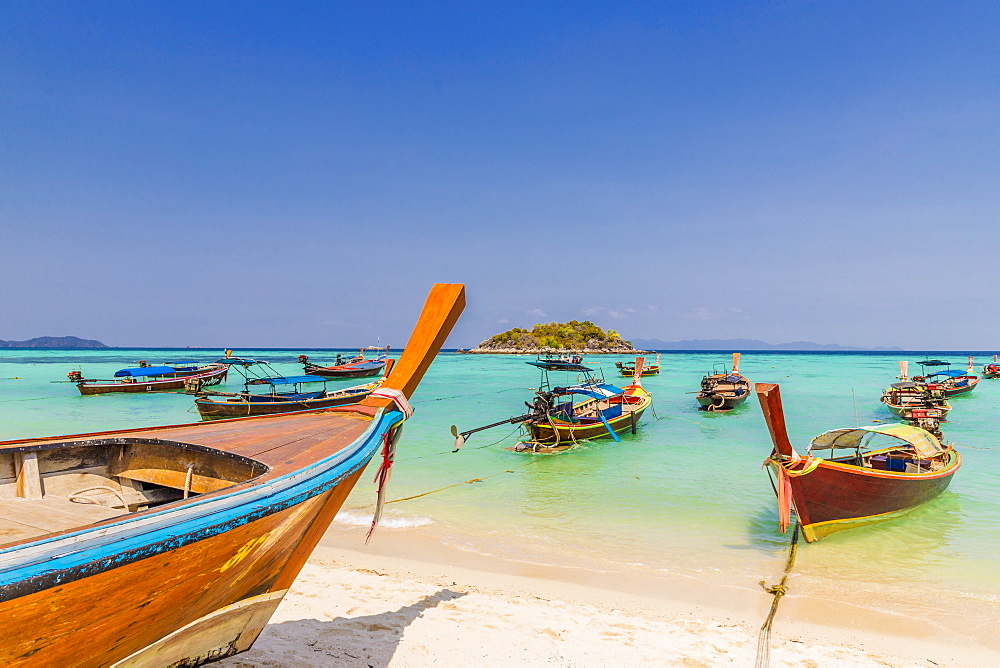 Longtail boats on Sunrise beach on Ko Lipe in Tarutao National Marine Park, Thailand, Southeast Asia, Asia.
