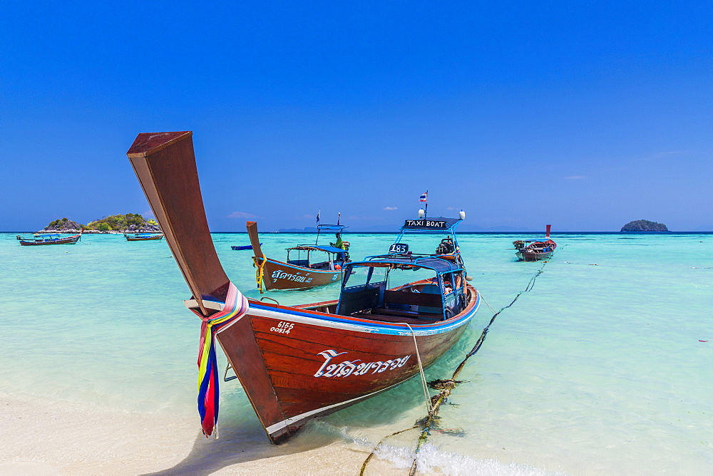 Colourful long tail boats on Ko Lipe island in Tarutao National Marine Park, Thailand, Southeast Asia, Asia.