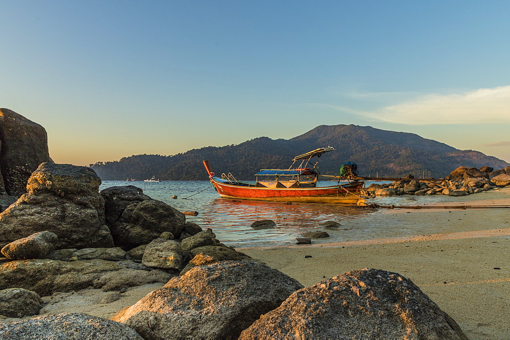A long tail boat at dusk in Ko Lipe, Tarutao National Marine Park, Thailand, Southeast Asia, Asia.