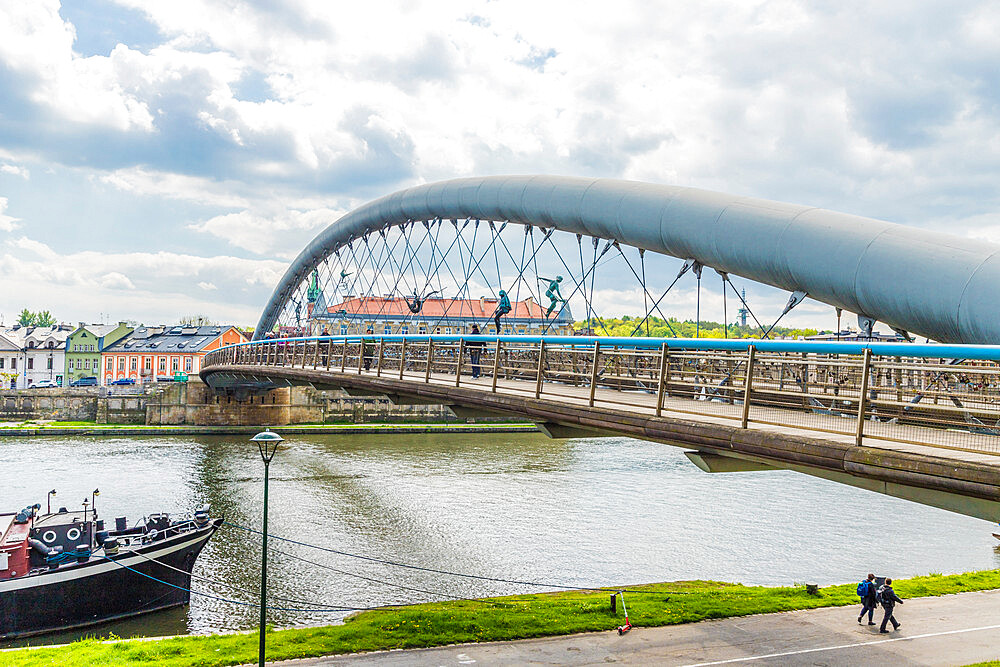 The Bernatka suspension foot bridge over the Wisla River in Krakow, Poland, Europe.