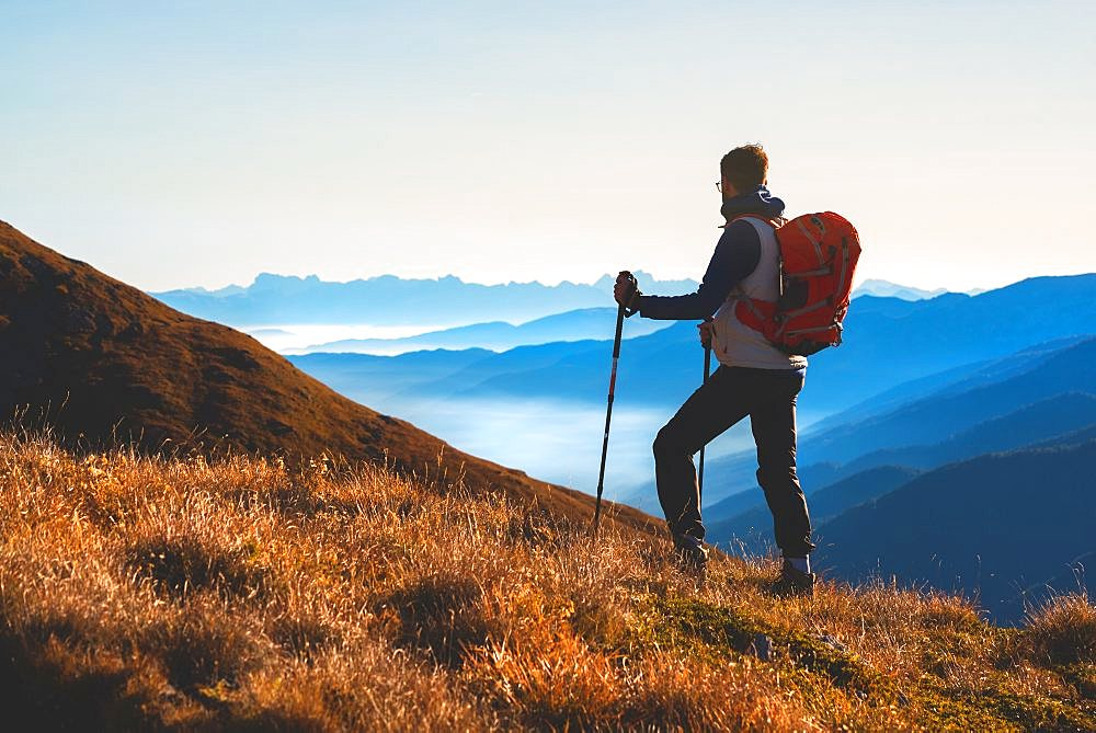 Mountain trekker in Autumn Season in Stelvio National park in Brescia province, Lombardy district, Italy, Europe.