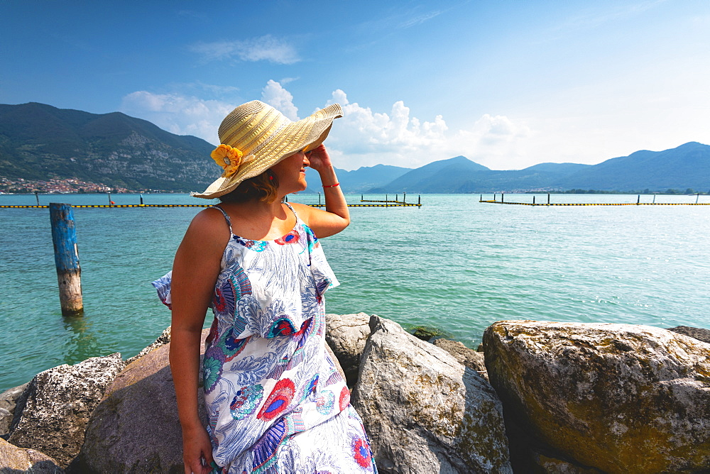 Woman admiring Lake Iseo, Clusane d'Iseo, Brescia province, Lombardy, Italy, Europe - 1299-61