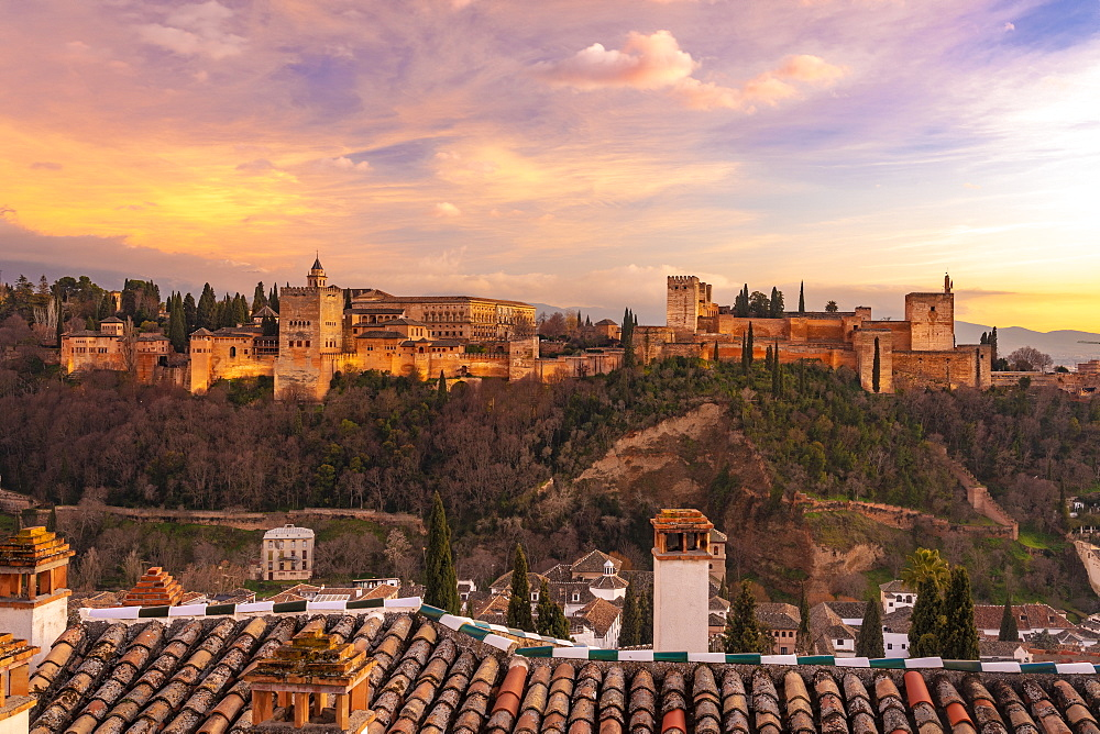 View of the Alhambra, UNESCO World Heritage Site, with the Sierra Nevada mountains in the background, at sunset, Granada, Andalucia, Spain, Europe