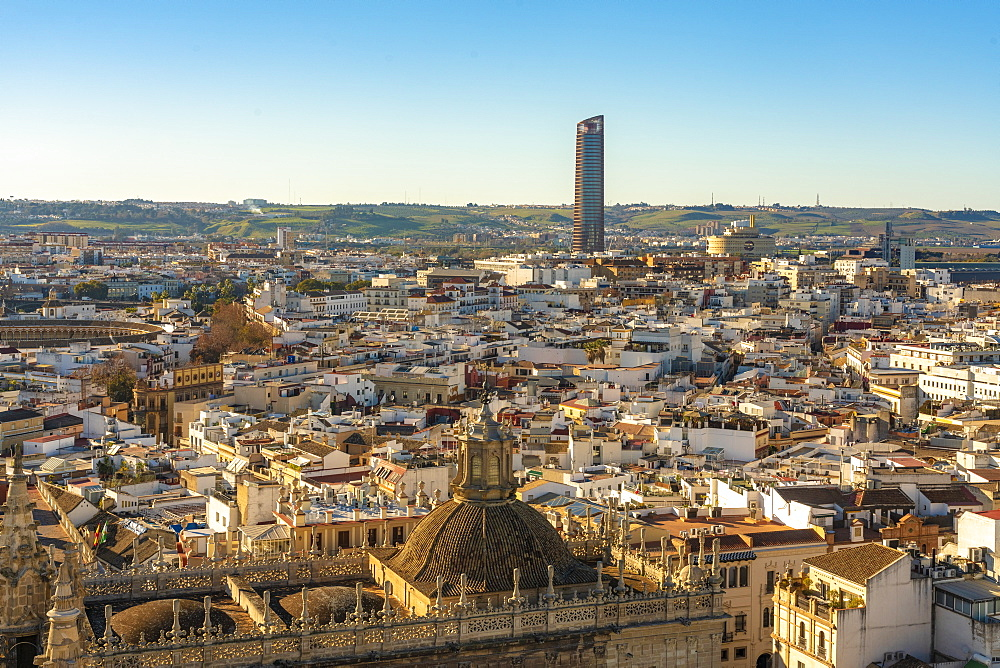 View of the historic center of Seville with Torre Sevilla or the tower of Seville in the background
