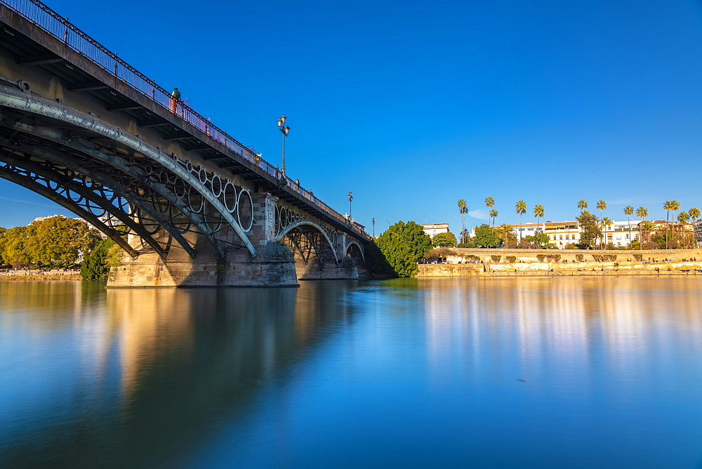 Long exposure of Puente de Triana on Guadalquivir River with Seville in the background, Seville, Andalucia, Spain, Europe