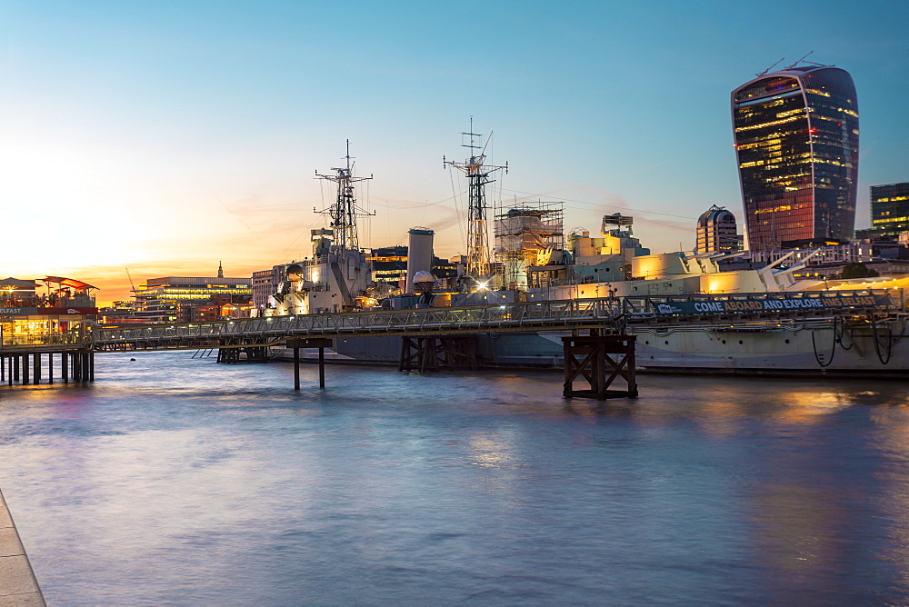 Skyline of city of London at sunset with Hms Belfast in the foreground - 1300-166
