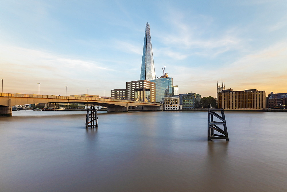Long exposure of the River Thames with London Bridge and The Shard in the background by sunset, London, England, United Kingdom, Europe