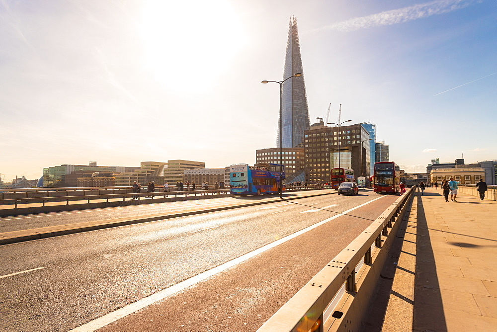 London Bridge with red buses and The Shard in the background, London, England, United Kingdom, Europe