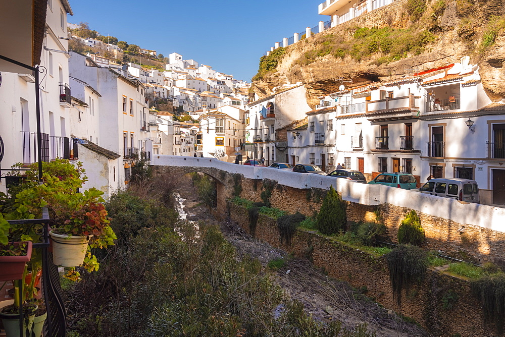 Setenil de las Bodegas in the province of Cadiz, with its white historic buildings and the houses under the rock mountain - 1300-205