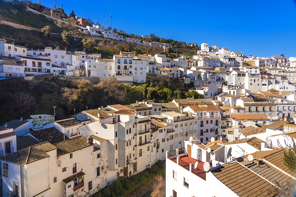 Overview of The Setenil de las Bodegas, with its white historic buildings and the houses under the rock mountain - 1300-206