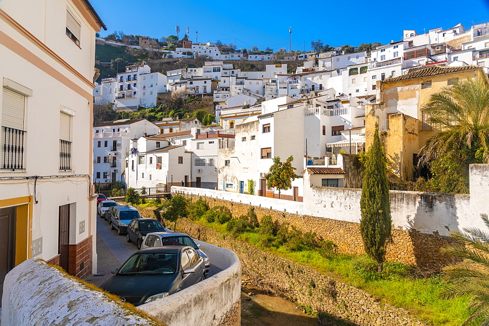 Overview of The Setenil de las Bodegas, with its white historic buildings and the houses under the rock mountain - 1300-208